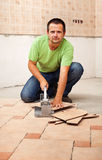 Man cutting ceramic floor tiles Stock Image