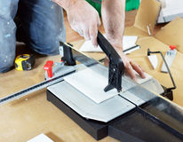 Man cutting ceramic tile Royalty Free Stock Image
