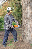 Man cutting with chainsaw Stock Images