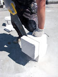 Man cutting concrete block Stock Photos