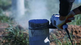 Man cutting a concrete column. Sparks of metal and concrete dust stock footage