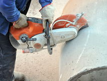 Man cutting concrete pipe Royalty Free Stock Photos
