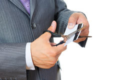 Man cutting credit card Royalty Free Stock Images