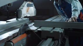 Man cutting detail in workshop stock video footage