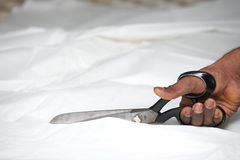 Man cutting fabric Royalty Free Stock Images