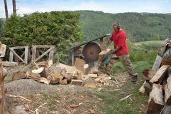 Man cutting firewood, preparing for winter Royalty Free Stock Photos