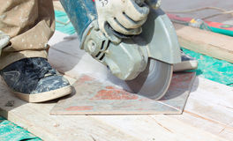 A man cutting a floor tiles Royalty Free Stock Photography