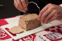 Man cutting foie gras with butter knife Stock Image