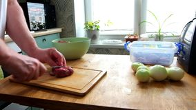 Man cutting fresh fillet meat pork on pieces to cook shashlik, hands closeup. He cutting on wooden board kitchen table. stock video footage