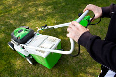 Man Cutting Grass. Activities - Gardening. Man cutting the lawn Royalty Free Stock Photography