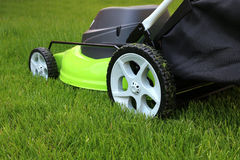 Man cutting the grass with lawn mower Royalty Free Stock Photos