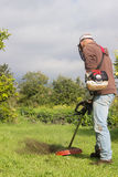 Man cutting grass Royalty Free Stock Images