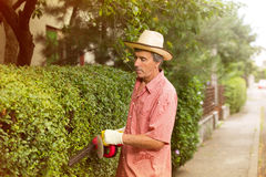 Man cutting a hedge with a hedge cutter Royalty Free Stock Photo