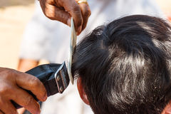 Man is cutting hill-man's hair Stock Images