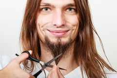 Man cutting his beard Royalty Free Stock Photos