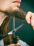 Man cutting his beard Royalty Free Stock Photo