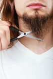 Man cutting his beard Stock Image