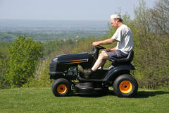 Man cutting his lawn Stock Photo