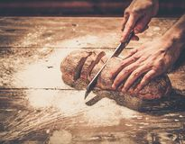 Man cutting homemade bread Royalty Free Stock Images