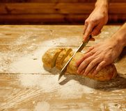 Man cutting homemade bread Stock Photos