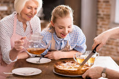 Man cutting homemade pie Stock Images