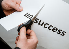 Man cutting inscription on a paper with scissors Royalty Free Stock Photos