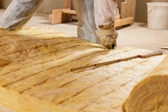 Man cutting insulation material for building Royalty Free Stock Photo
