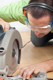 Man cutting laminate floor plank Stock Photo