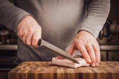 Man cutting lard Stock Photo