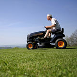 Man cutting lawn Royalty Free Stock Photo