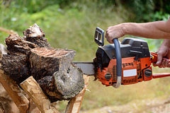 Man cutting lumber with chainsaw Royalty Free Stock Photo