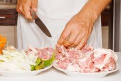 Man cutting meat Royalty Free Stock Photos