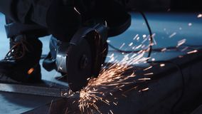 Man cutting metal with grinder stock video footage