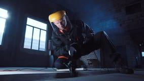 Man cutting metal using grinding machine stock video