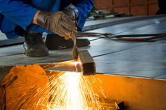 Man cutting metal with a welding cutting torch Stock Image