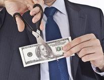 Man cutting money. Business Man cutting money - 100 dollars Stock Photography