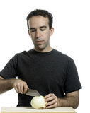 Man Cutting Onion Stock Photography