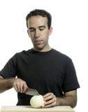 Man Cutting Onion Stock Photography