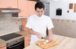 Man cutting onion Royalty Free Stock Images