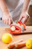 Man cutting paprika in kitchen Stock Image