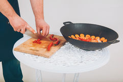 Man cutting pepper Stock Photos