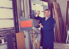 Man cutting plywood with electric saw Royalty Free Stock Photography