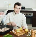 Man cutting potato Royalty Free Stock Photos