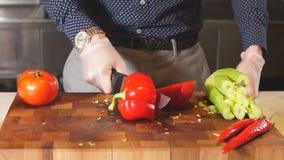 Man cutting a red pepper