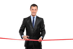 A man cutting a red ribbon, opening ceremony Stock Photos