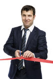 A man cutting a red ribbon, opening ceremony Stock Photo