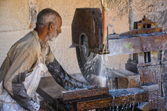 A man cutting salt to make Tiles. With cutting machine – Somewhere near Quaidabad, Khushab, Punjab, Pakistan Royalty Free Stock Image