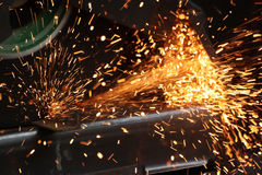 Man cutting steel with the machine. Man cutting steel with spraks Stock Image