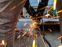 Man Cutting Steel Using A Power Tool Royalty Free Stock Image