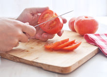 Man cutting tomato Royalty Free Stock Photo